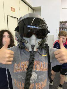 Roman trying on flight helmet