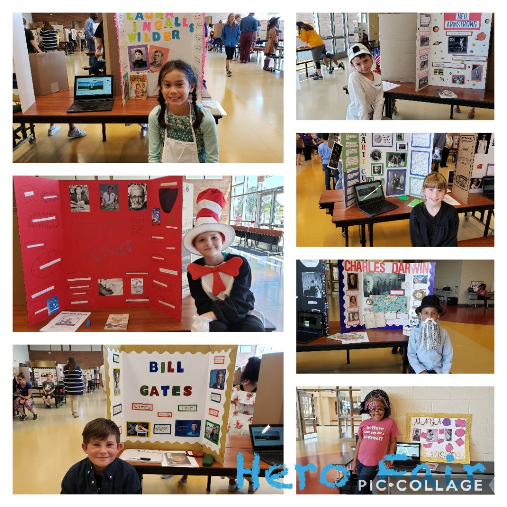 Students in front of their Hero Reports on Hero Fair Day