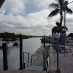 Bay Pines Marina, Saint Petersburg, Florida. Look down at the inlet Palm trees and flags waving on a windy day.