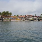 John's Pass Village in Madeira Beach Florida. Looking at water and shops sunny and blue shy.