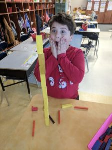 Students completing 100th Day STEM Challenge