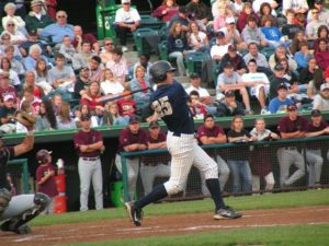 Center Fielder Kyle Caruthers takes a swing against State College.