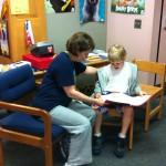 Ethan reads with Mrs. Etzweiler