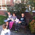 Gavin, Madelyn, Brett on the bench in the shade!