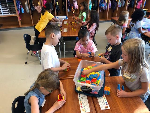 students exploring morning tubs