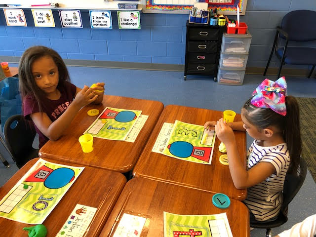 students using playdough for math review