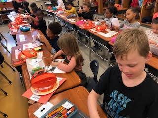 students at pumpkin stations