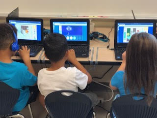 students working at math station